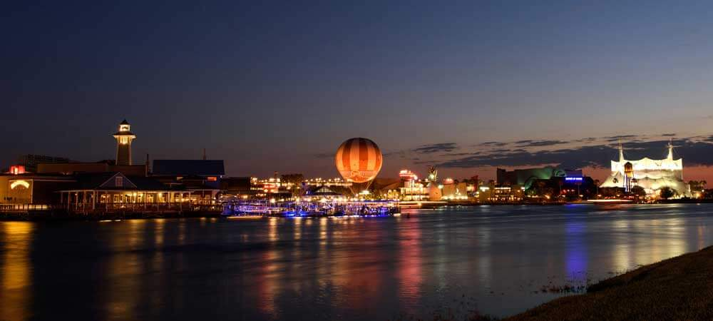 Landscape photo of Disney Springs at night.
