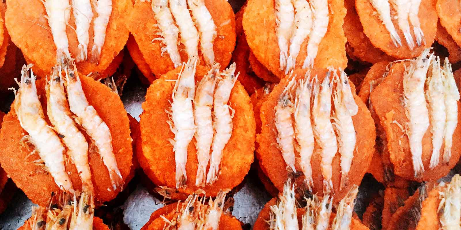 Get to know Colombo, Sri Lanka on a tuk tuk safari. You'll hear, see, smell, and taste all the city has to offer - like these brightly colored prawn cakes from a street food vendor at Galle Face.