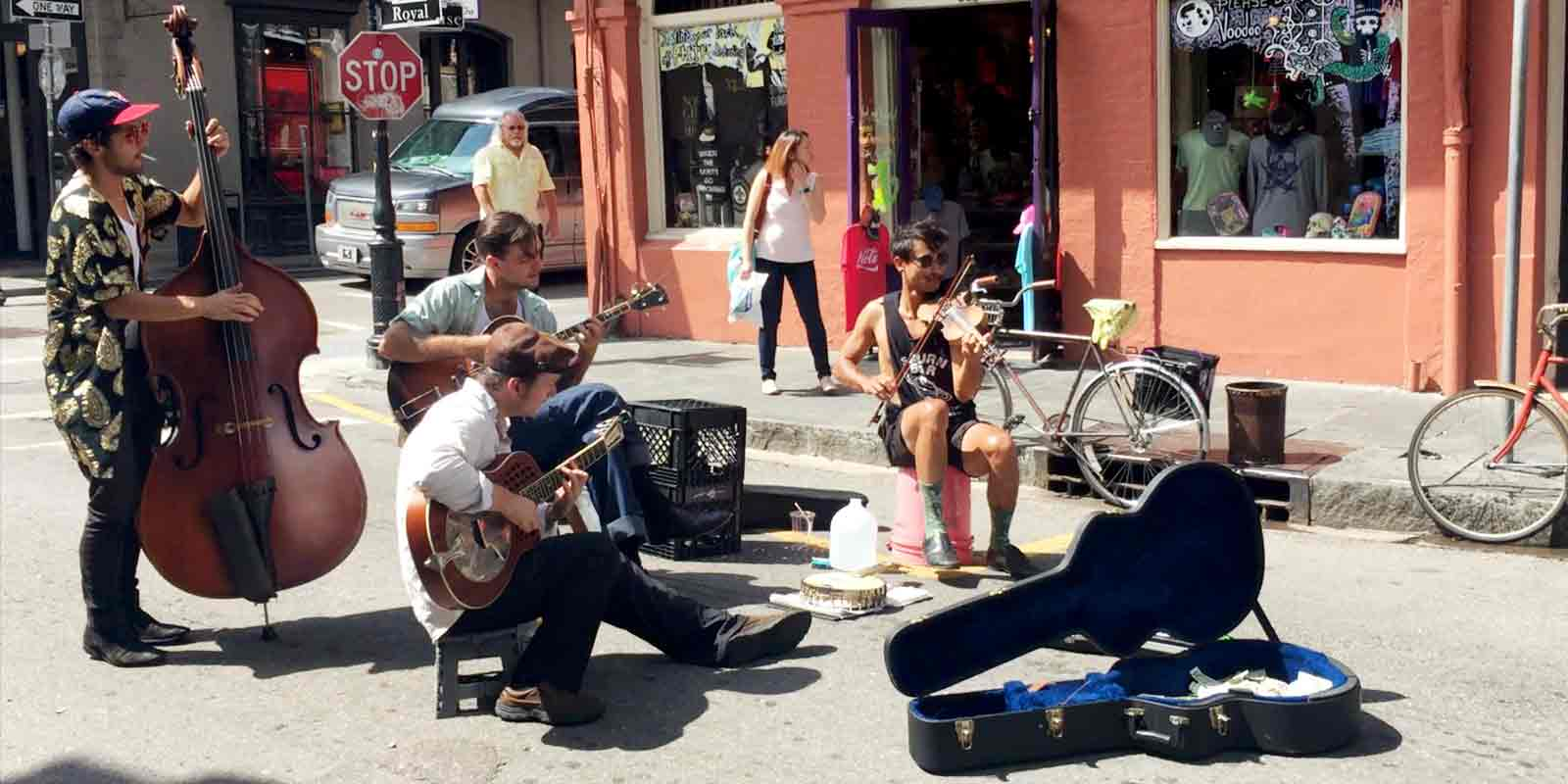 New Orleans travel tips: Street musicians perform on Royal St. in the New Orleans' French Quarter. If you stop to listen to a street musician, leave a tip!
