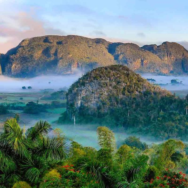 Now that you know the rules of visiting Cuba as an American, be sure to schedule a visit the Viñales Valley. This lush valley is one of 9 UNESCO World Heritage sites in Cuba.