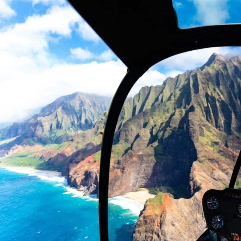 View of the Na Pali Coast of Kauai from inside a helicopter.