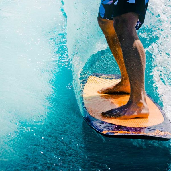 Learn to surf in Hawaii, among many other water sports!
