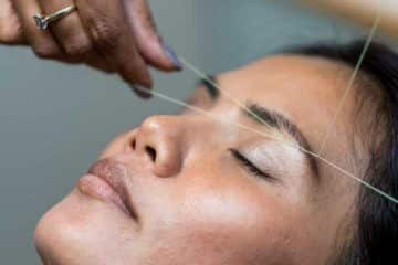 closeup of a woman getting her eyebrows threaded