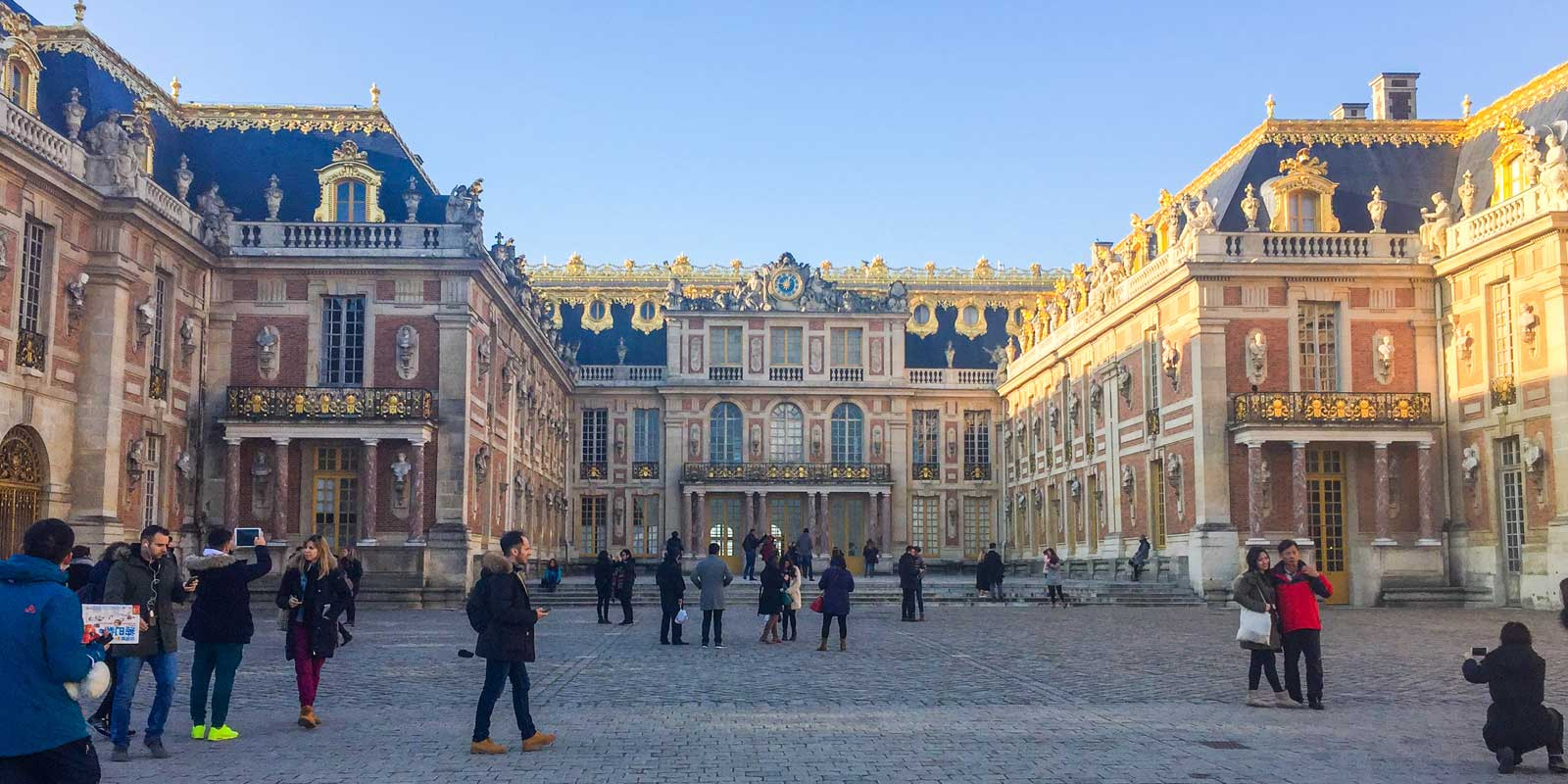 Front courtyard looking at the Château de Versailles in the afternoon sun.