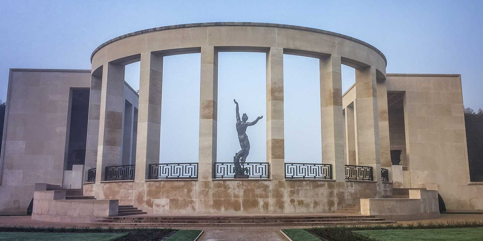 Open air building with a sculpture at the World War II Normandy American Cemetery in France.