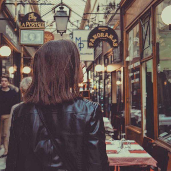 Woman browsing through a shopping hall in Paris, France.