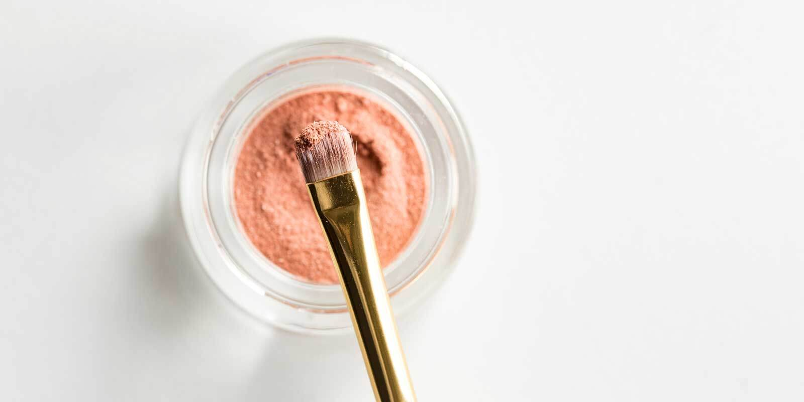 Closeup of a powdery makeup and makeup brush