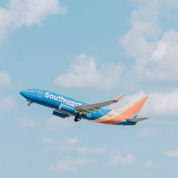 Overhead sky shot of a Southwest Airlines plane flying by.