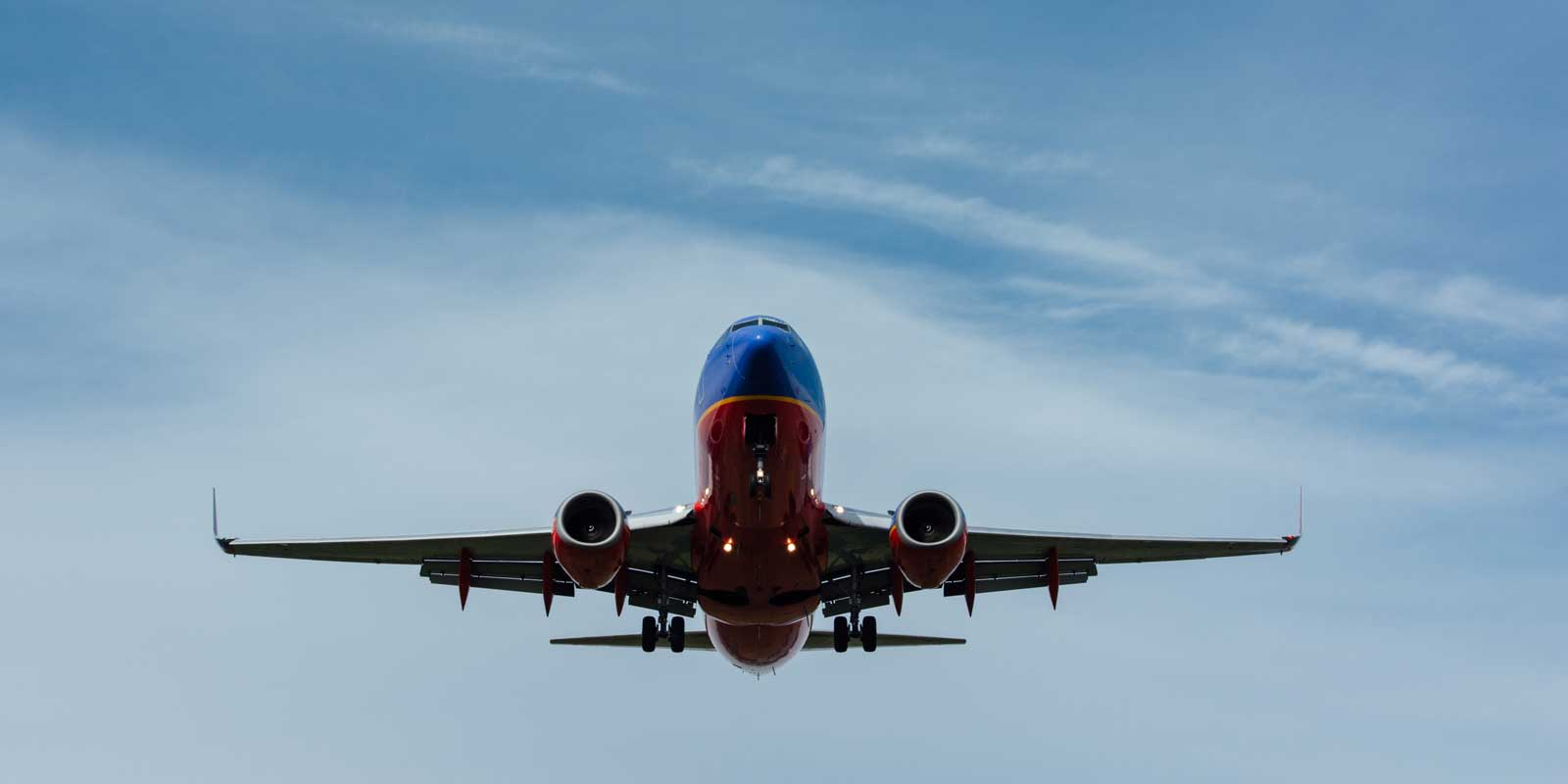 Overhead view of a Southwest Airlines plane flying above