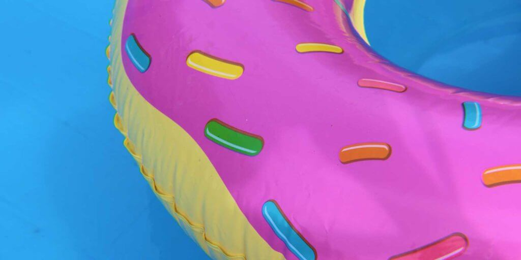 Closeup of a donut pool float in a pool.