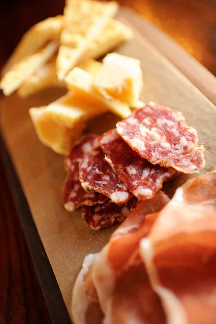 Close up of a meat and cheese platter.