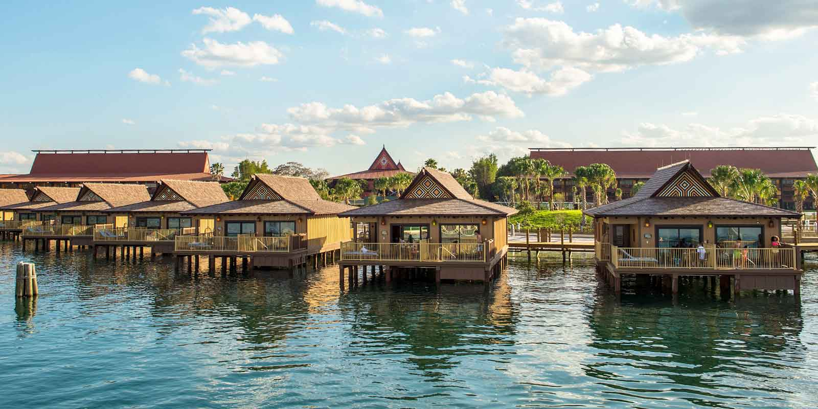 Landscape view of a row of Polynesian-style overwater villas at Disney World.