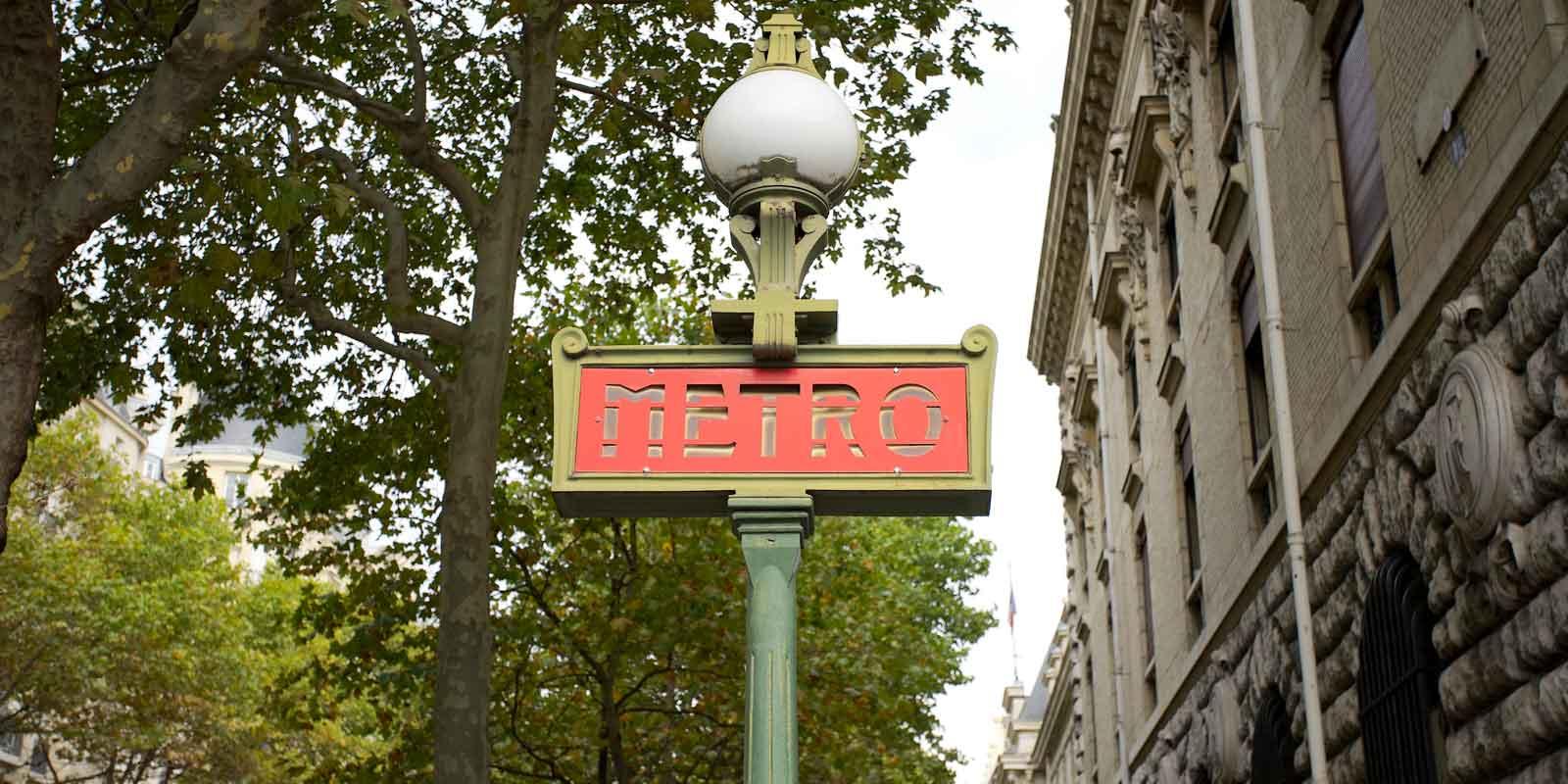 Closeup photo of a Metro entrance sign in Paris