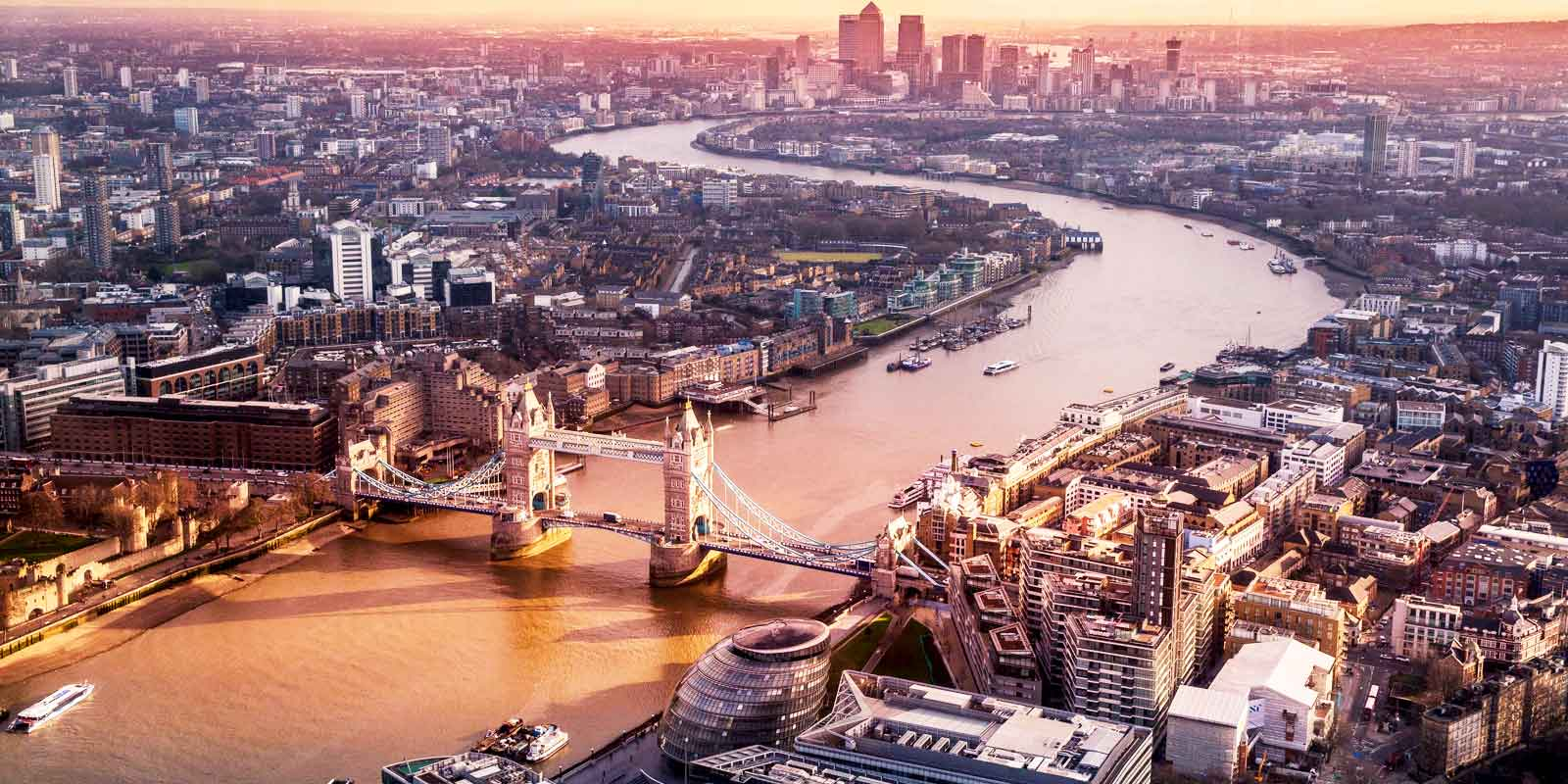 Aerial landscape view of the Tower Bridge in London and surrounding neighborhoods.