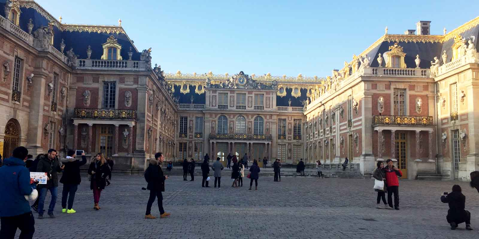 Landscape view of Château de Versailles from the courtyard
