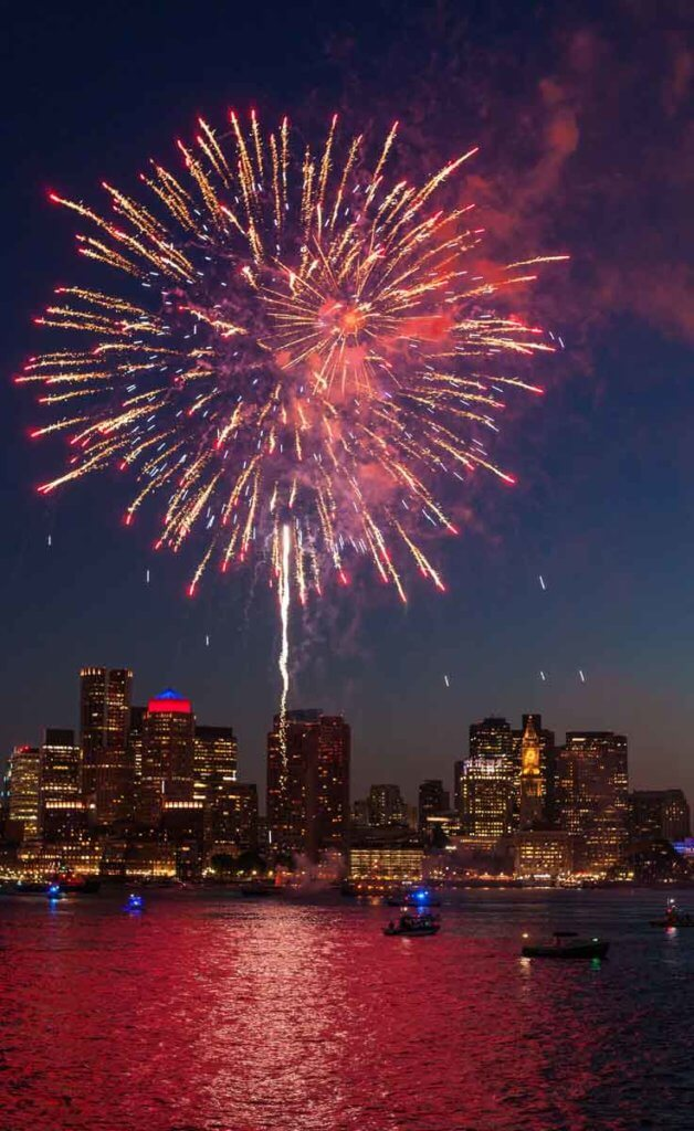 Fireworks burst over the Charles River for the Boston Pops Fireworks Spectacular.