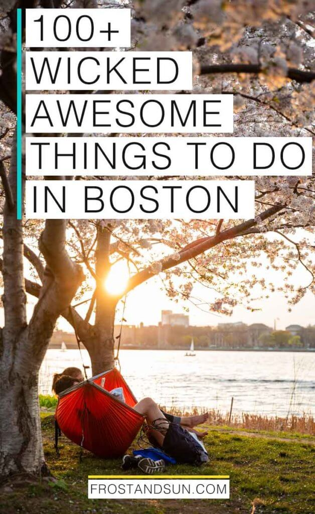 "Portrait view of the Charles River Esplanade at sunset with a couple in a red hammock strung between 2 flowering cherry blossom trees. Overlying text reads ""100+ Wicked Awesome Things to Do in Boston."""