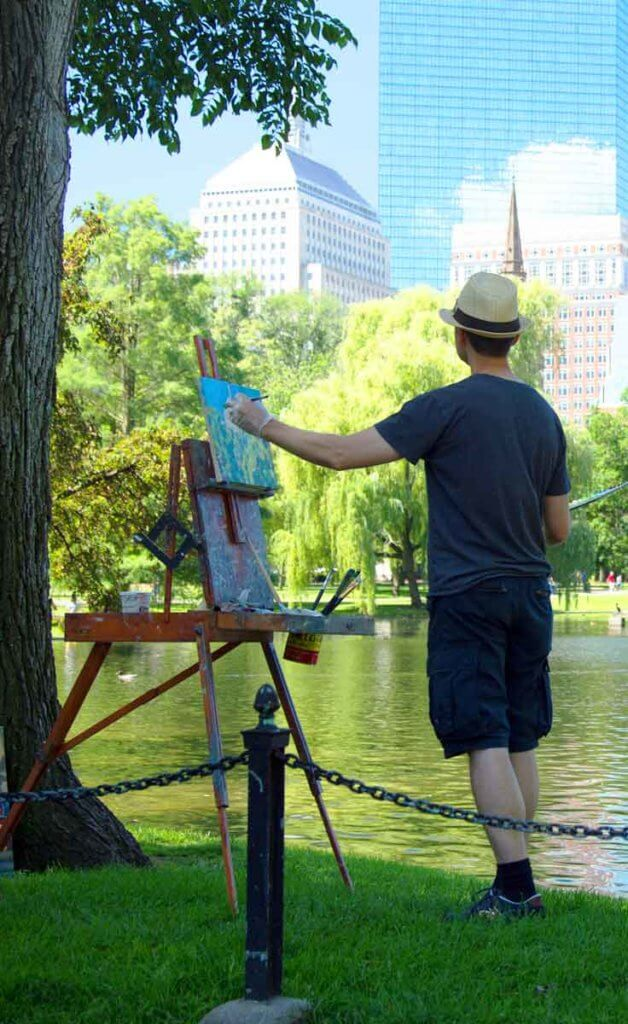 Man paints a landscape in the Boston Public Garden.
