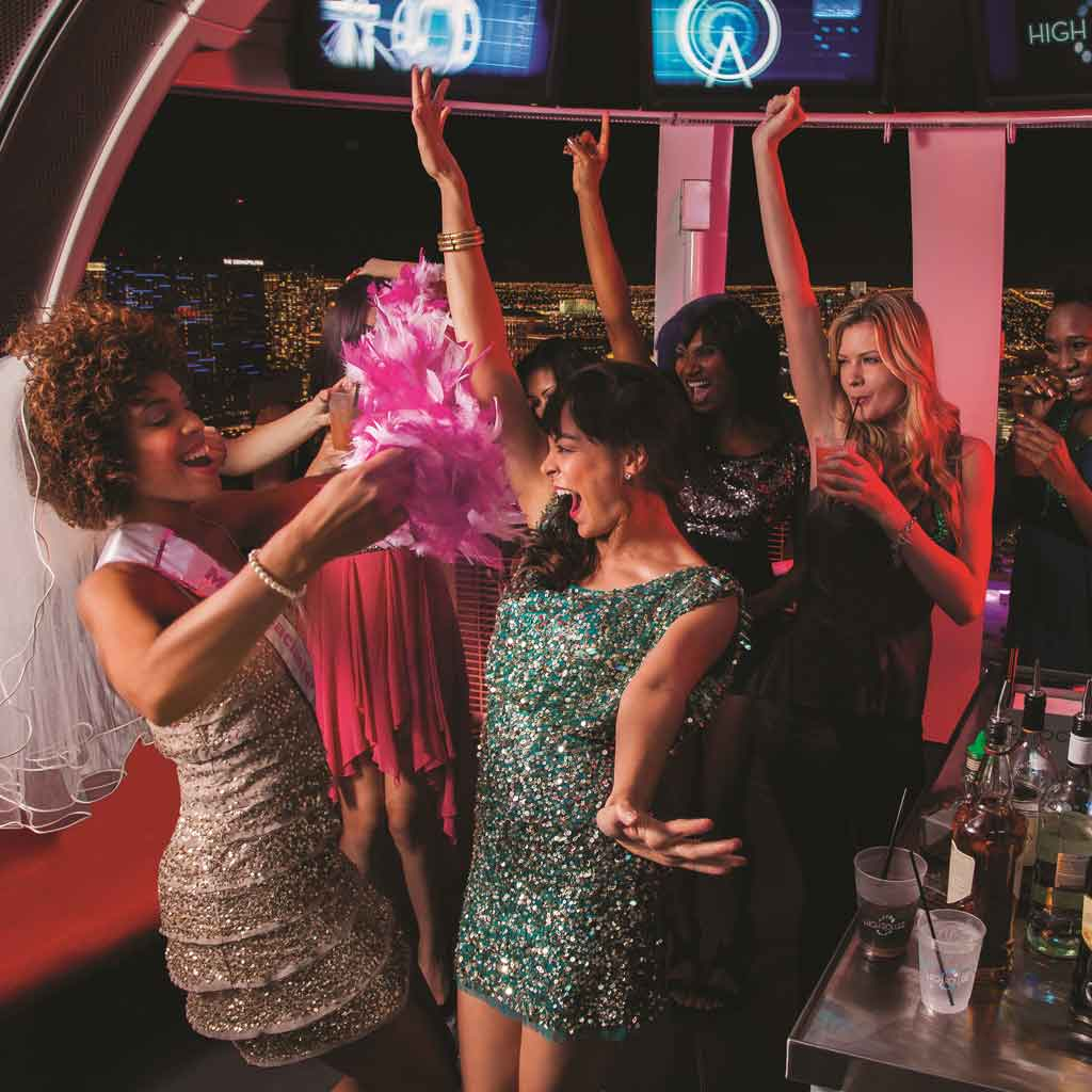 Photograph of a bachelorette party on the High Roller ferris wheel in Las Vegas.