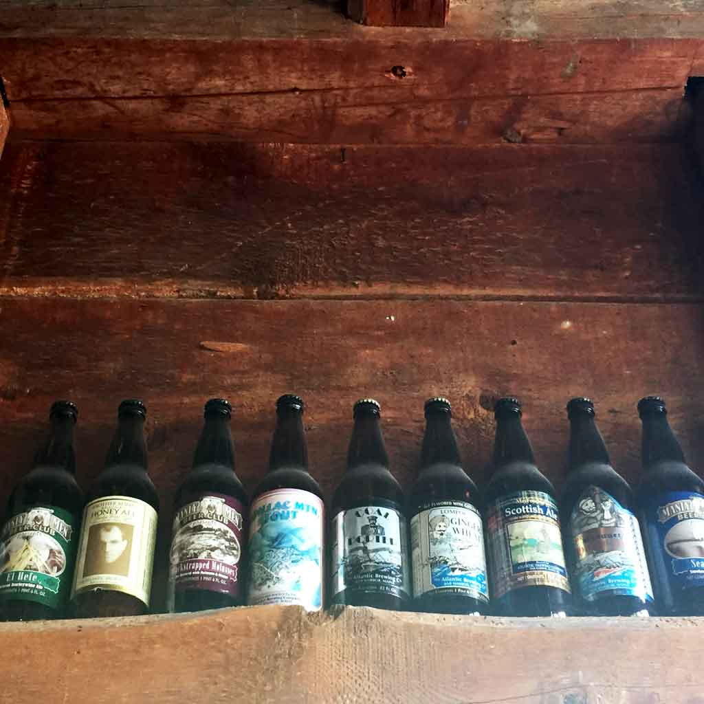 Closeup of beer bottles from Atlantic Brewing Company on a shelf.