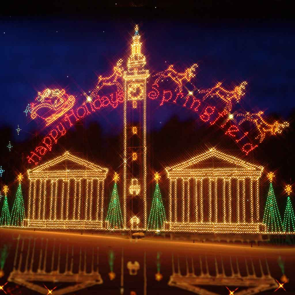 "A massive holiday light display at Forest Park in Springfield, MA. The sign reads ""Happy Holidays, Springfield."""