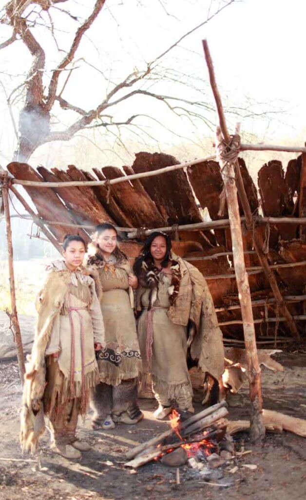 Three Wampanoag Native American women pose for a photo at Plimoth Plantation.