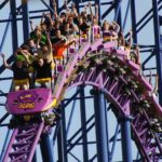 Closeup of people riding the Bizarro roller coaster at Six Flags New England.