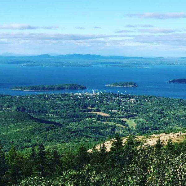 Aerial view of Bar Harbor, Maine and the Atlantic Ocean with several small islands.