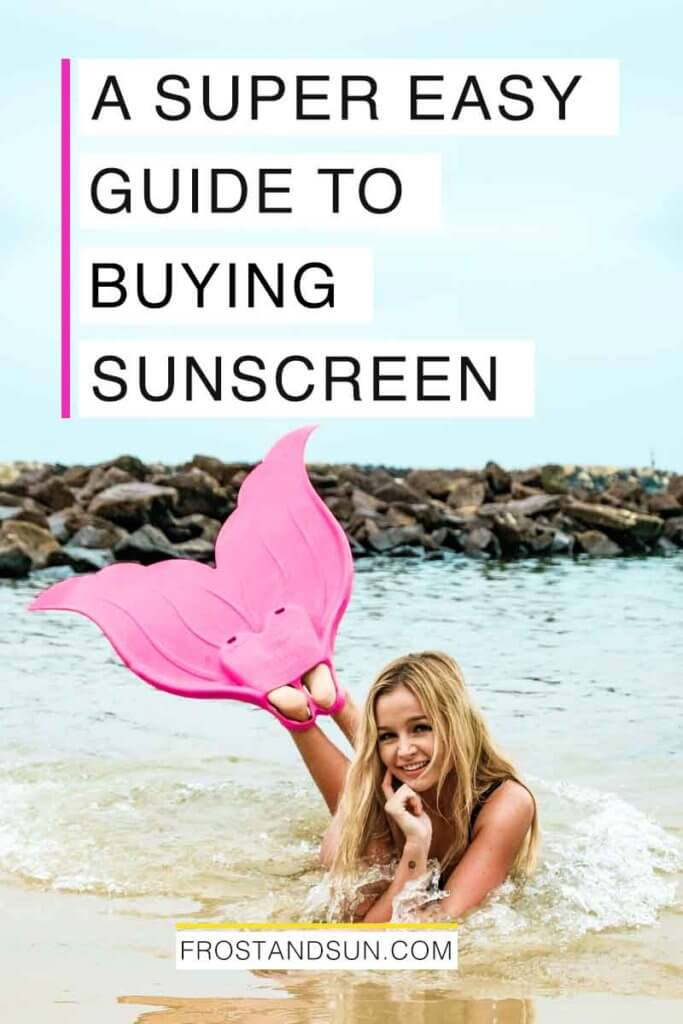 """View of a woman laying on her stomach in the ocean wearing rubber mermaid style flippers. Overlying text reads """"A Super Easy Guide to Buying Sunscreen."""""""