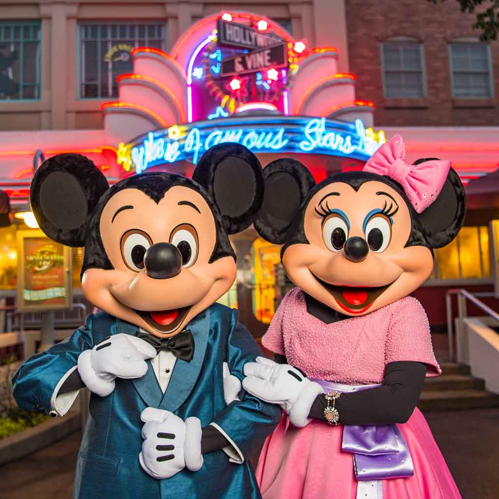 Photo of Mickey and Minnie Mouse in fancy outfits in front of the Hollywood & Vine restaurant.
