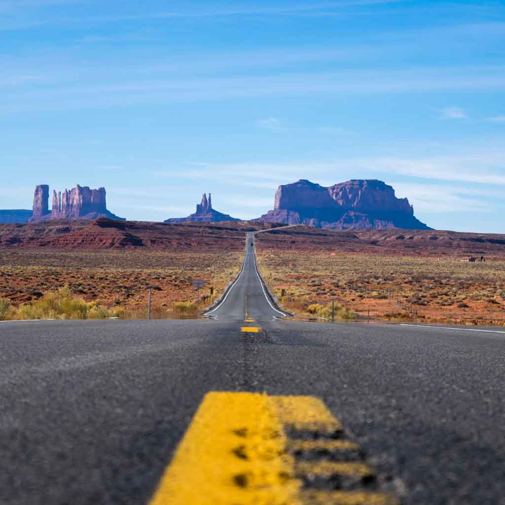 Landscape view of the road driving toward Monument Valley.