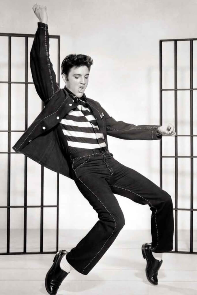Historical photograph of singer Elvis Presley dancing.