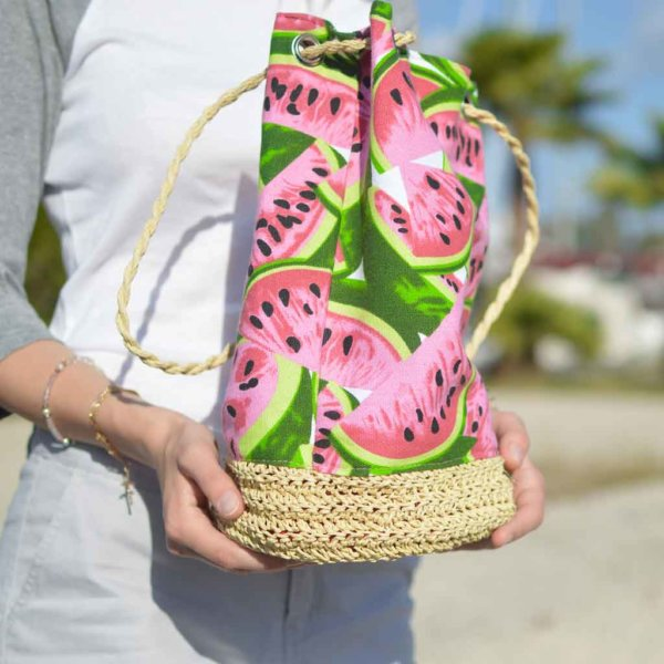 Closeup of a person cradling a large watermelon print tote.