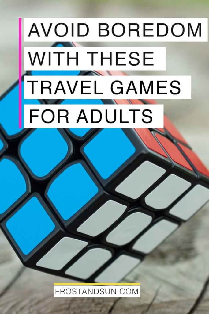 "Closeup photo of a Rubix Cube. Overlying text reads ""Avoid Boredom with These Travel Games for Adults."""