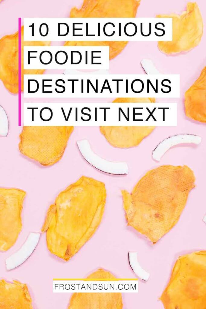 "Photograph of dried mango slices and shaved coconut artfully arranged atop a pink surface. Overlying text reads ""10 Delicious Foodie Destinations to Visit Next."""