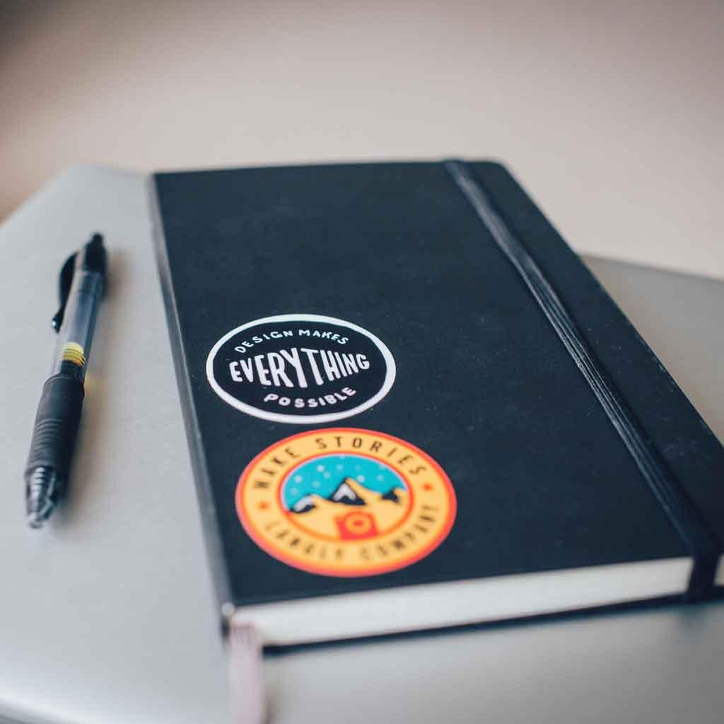 Closeup of a Moleskine journal and pen.