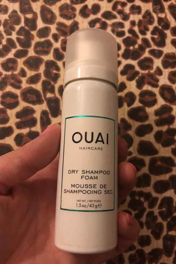 Photo of a travel sized can of Ouai Haircare Dry Shampoo Foam.