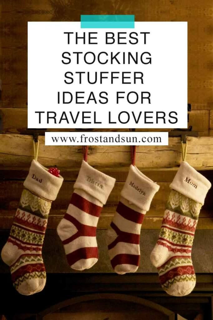 """Closeup of 4 knit Christmas stockings above a fireplace. Overlying text reads """"The Best Stocking Stuffer Ideas for Travel Lovers."""""""