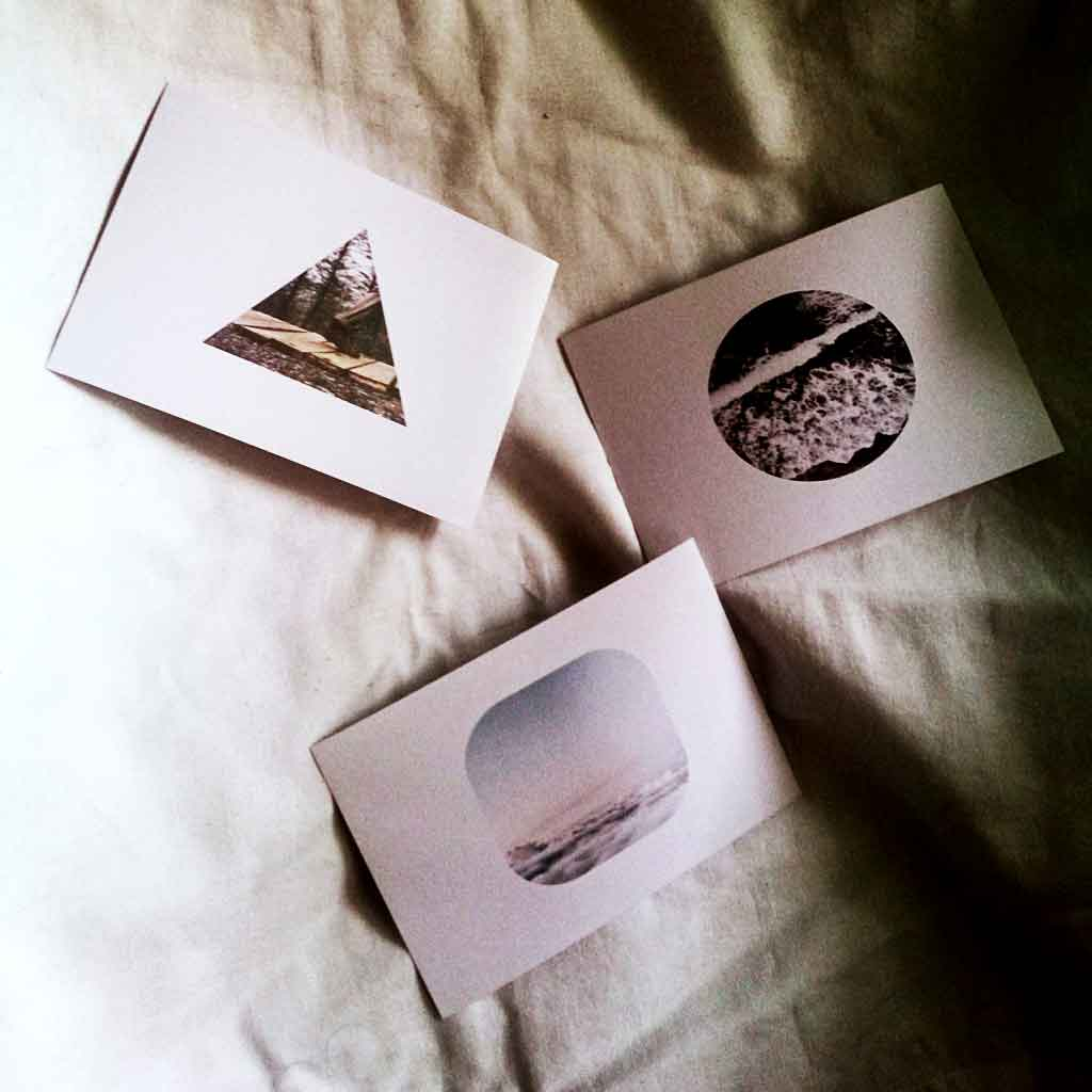 Photo of 3 greeting cards with pictures printed on them.