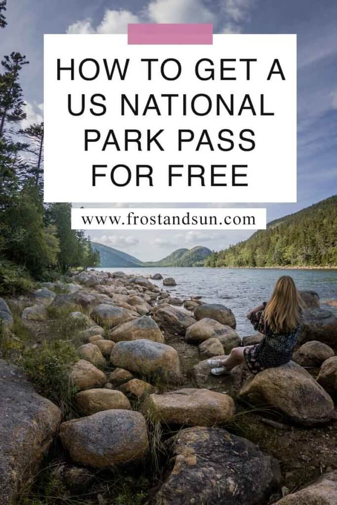 "Photo of a woman sitting on a rocky shoreline overlooking a lake with mountains in the background. Overlying text reads ""How to Get a US National Park Pass for Free"""