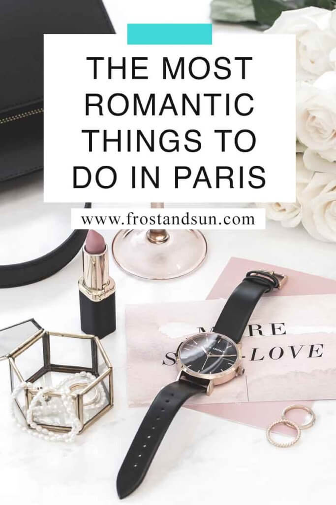 """Flat lay photo of a table with lipstick, white roses, watch, jewelry, and wedding bands. Overlying text reads """"The Most Romantic Things to Do in Paris."""""""