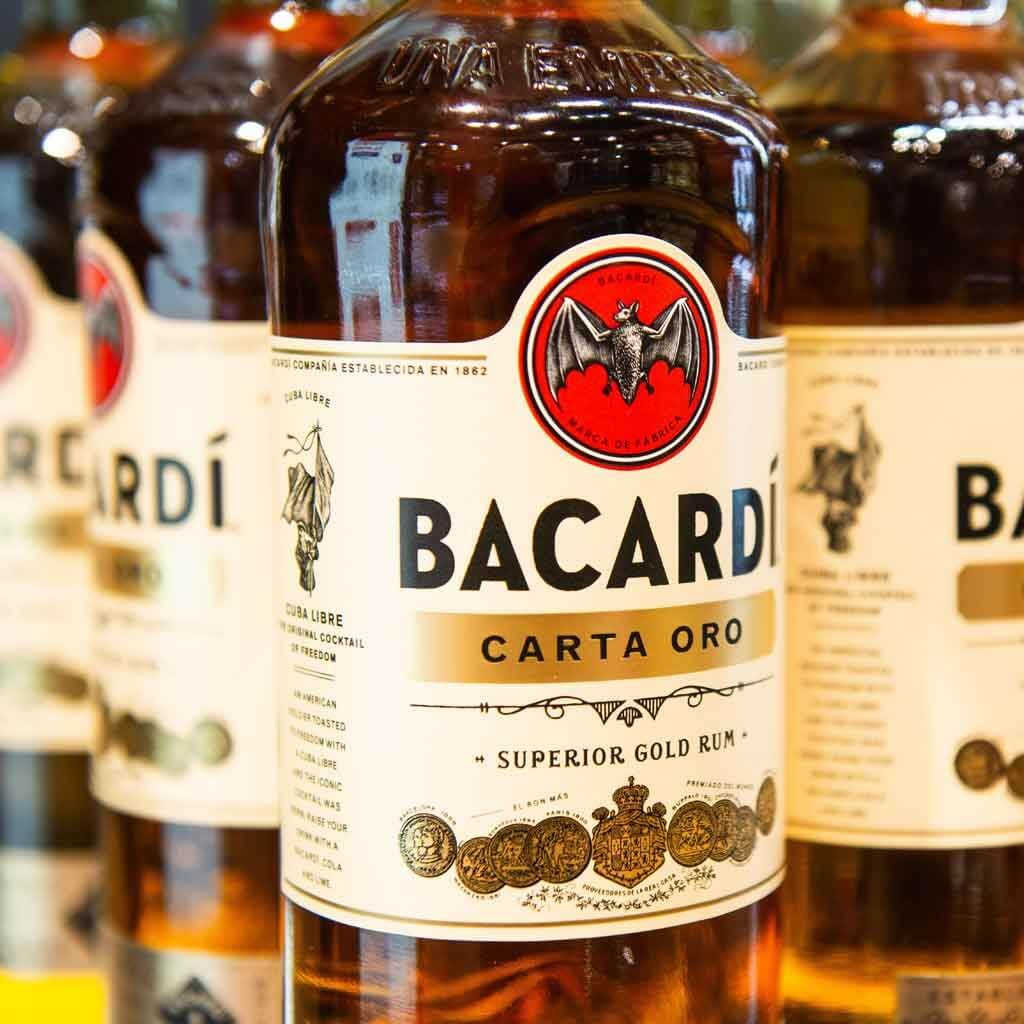 Closeup of bottles of dark Bacardi rum.