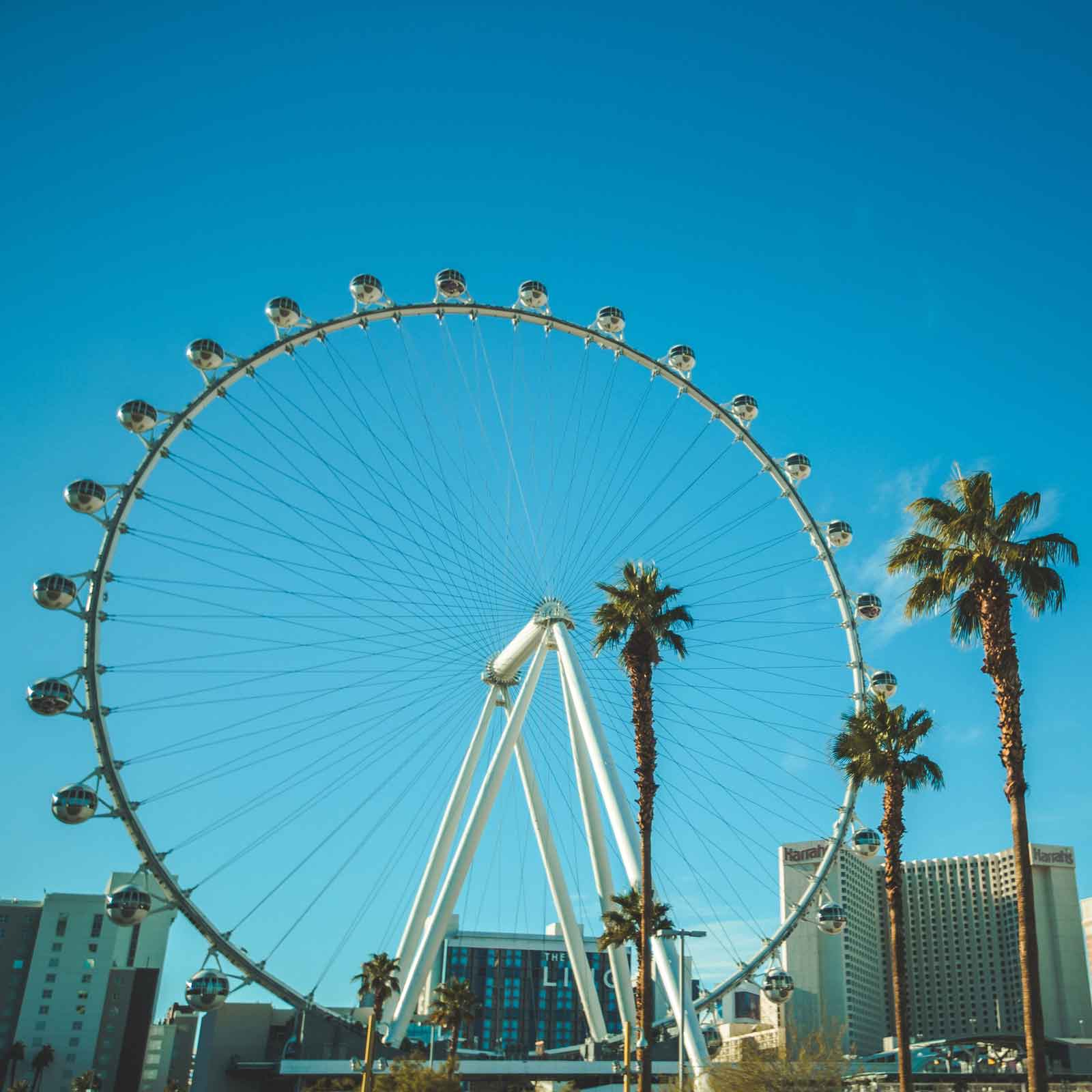 Photo of the High Roller ferris wheel in Las Vegas during the day with hotels in the background.