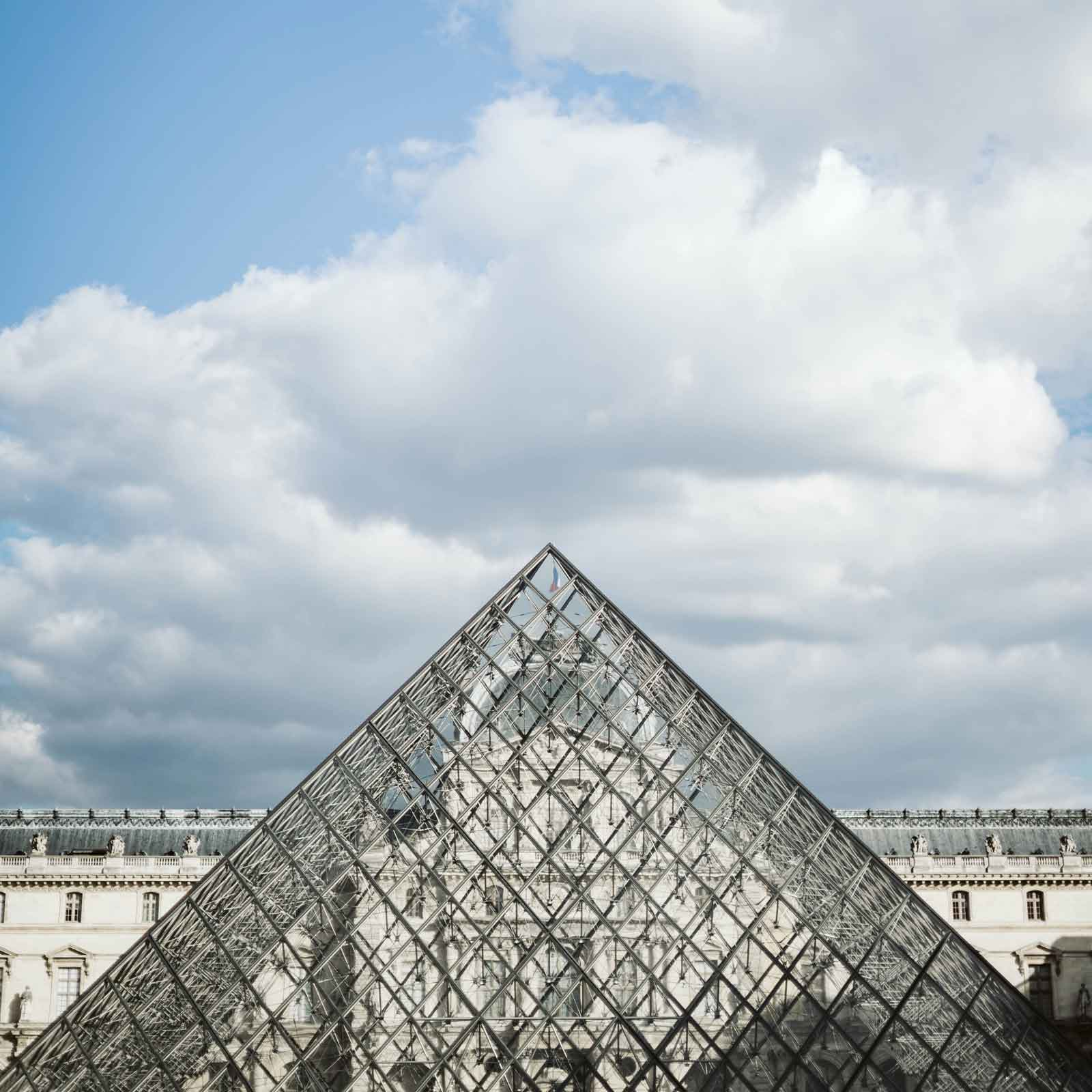 Photo of the glass pyramid outside the Louvre Museum in Paris.