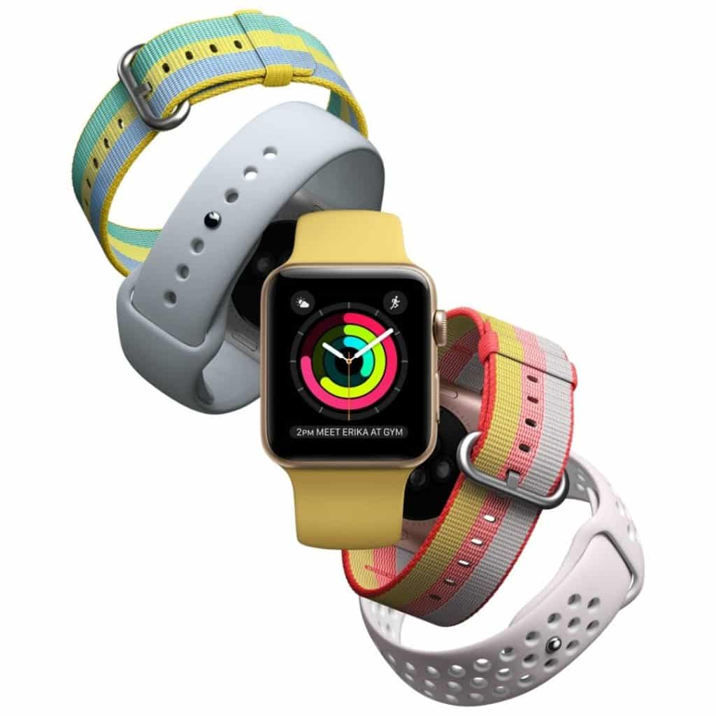 5 colorful Apple watches artfully arranged in a diagonal line.