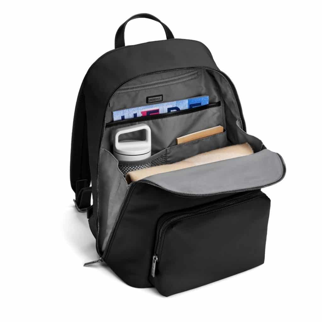 Photo of a backpack open to show its multiple organizational compartments.