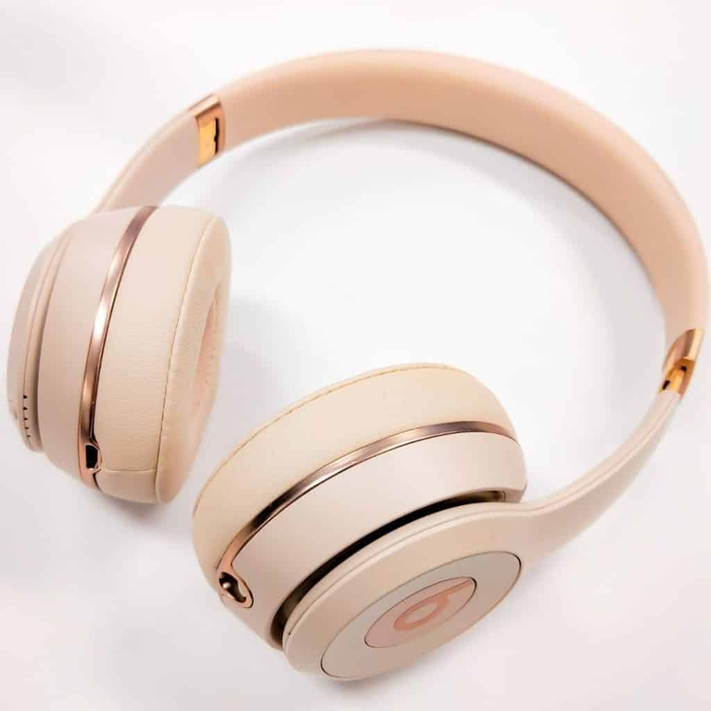 Closeup of rose gold Beats over-the-ear-headphones.