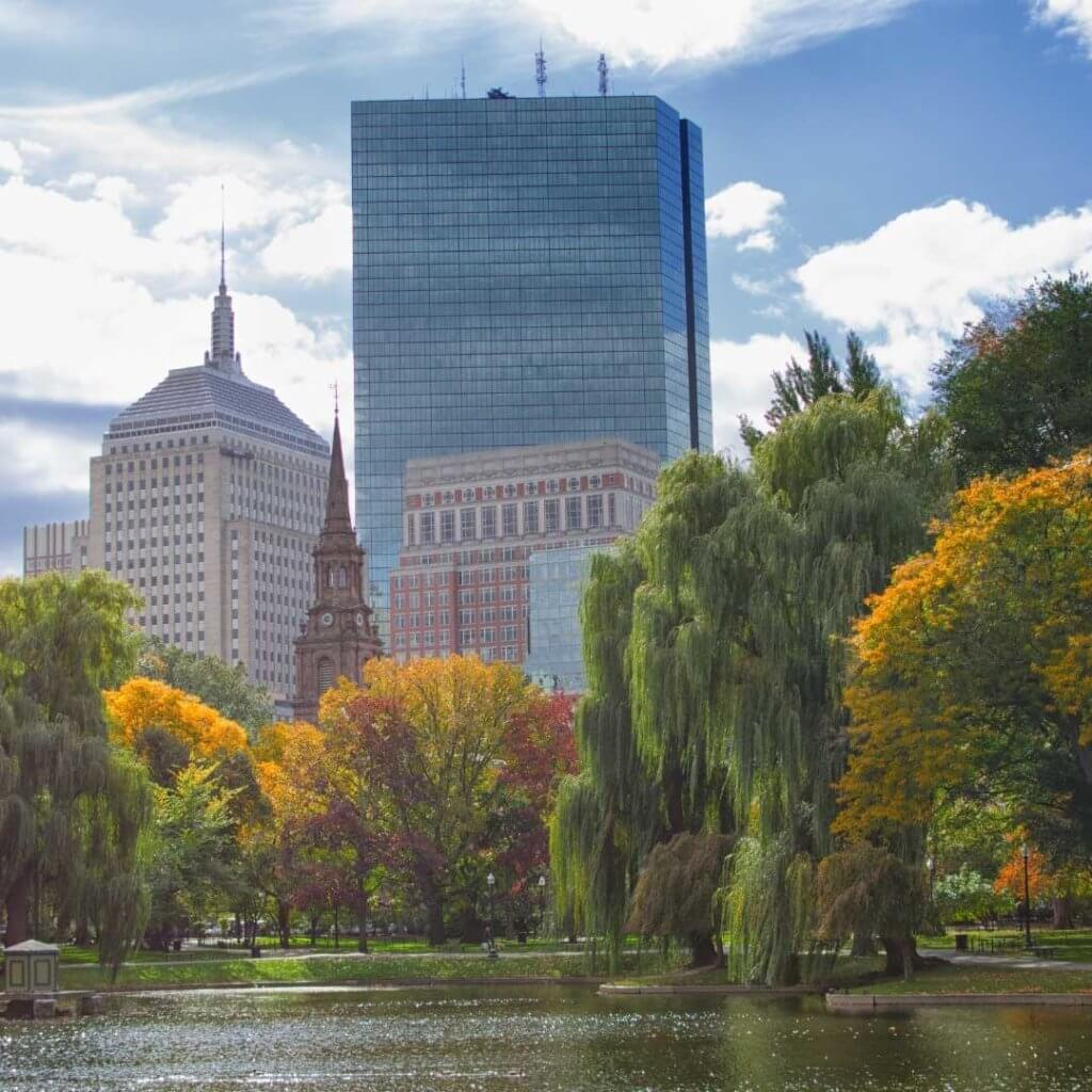 Photo of the Boston Public Garden in the Fall with yellow, red, and orange leaves on the trees.
