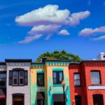 Photo of colorfully painted rowhouses in the Georgetown neighborhood of Washington, DC.