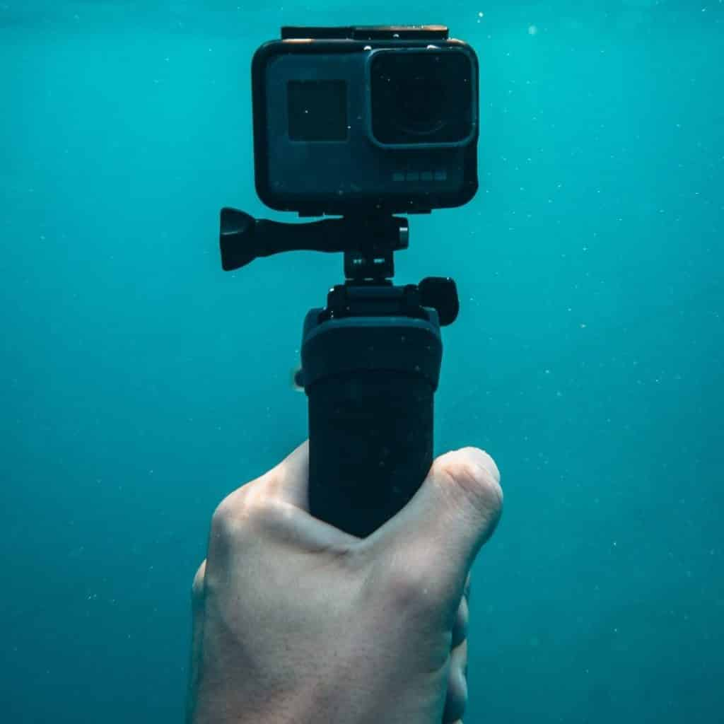 Closeup of a GoPro camera underwater.
